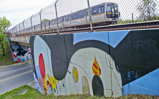 A MARTA train passes over the mural at the corner of Dekalb Ave. and Arizona Ave. on Thursday, April 17, 2014. Photo by: Photo: Jonathan Phillips