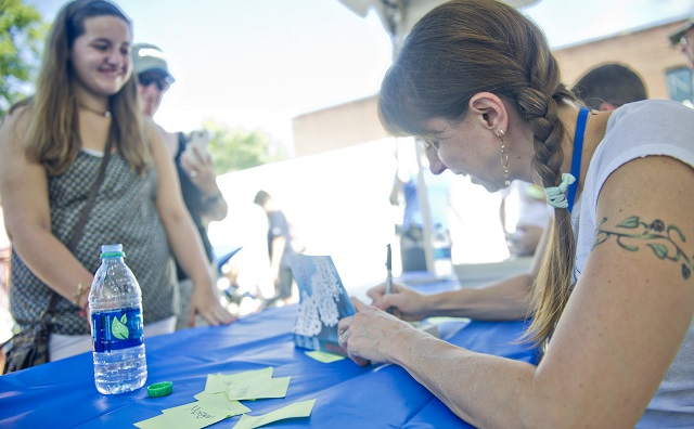 Photo: Jonathan Phillips  Lauren Myracle (right) signs a copy of her book for Hannah Mains during the AJC Decatur Book Festival on Saturday, August 30, 2014. The ninth annual event saw tens of thousands of people come out to the downtown Decatur area to meet with world-class authors, illustrators, editors, publishers, booksellers, and artists for a weekend filled with literature, music, food, art, and fun.