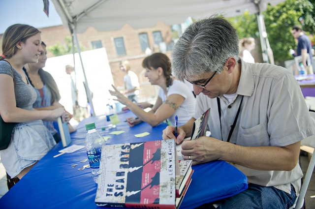 Photo: Jonathan Phillips  Len Vlahos (right) signs copies of his book during the AJC Decatur Book Festival on Saturday, August 30, 2014. The ninth annual event saw tens of thousands of people come out to the downtown Decatur area to meet with world-class authors, illustrators, editors, publishers, booksellers, and artists for a weekend filled with literature, music, food, art, and fun.