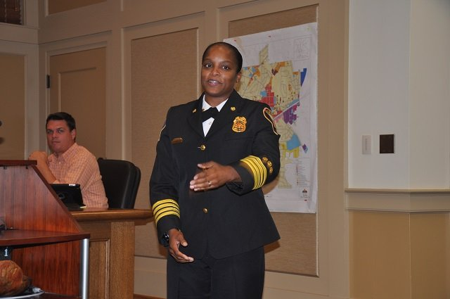Stephanie Burton, Decatur's new Deputy Fire Chief, introduces her family during the Sept. 2 Decatur City Commission meeting.  Photo by Dan Whisenhunt