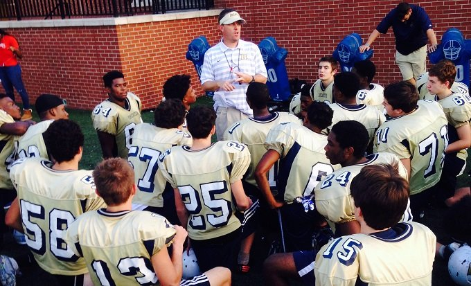 Head coach Scott Jackson talks to Decatur High's Football team during practice. Photo provided to Decaturish by Bill Banks.