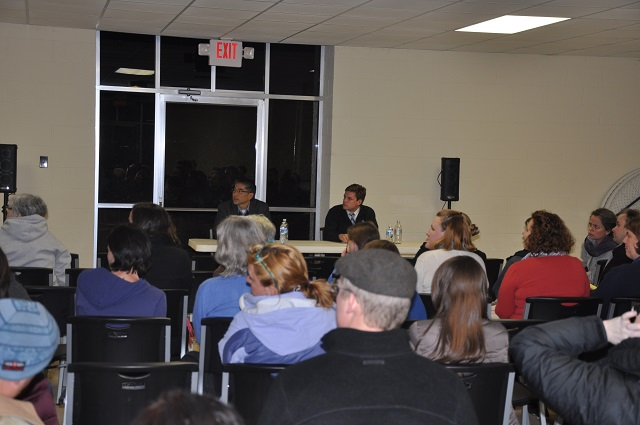 Atlanta City Councilman Alex Wan and Atlanta Public Schools Board of Education Member Matt Westmoreland speak during a meeting on annexation hosted by the Laurel Ridge Shamrock Civic Association. File Photo by Dan Whisenhunt