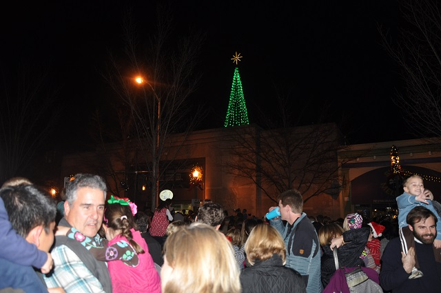 Parents and children celebrate the beginning of the Christmas season in downtown Decatur. Ga. Photo by Dan Whisenhunt