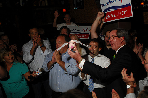 When pigs fly: Brookhaven Yes President J. Max Davis, left, Rep. Mike Jacobs, center, and Rep. Tom Taylor hold a toy flying pig as they celebrate the news that Brookhaven will become Georgia's newest city. Voters approved incorporating Brookhaven in the July 31, 2012 primary. Photo obtained via Reporter Newspapers