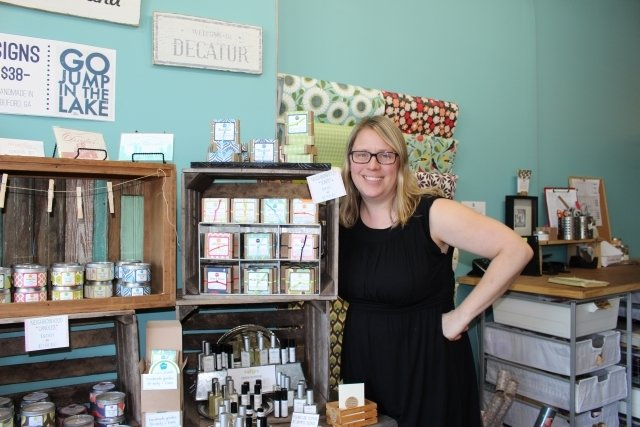 Mama Bath + Body owner Emilie Sennebogen Bryant with her Atlanta neighborhood scented products. Photo by Dena Mellick