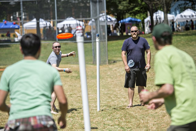 Ryan Reilly (center left) and Josh Meister play a game of Beersbie against brothers Will and Philip Juras during the Kirkwood Spring Fling.  Photo: Jonathan Phillips