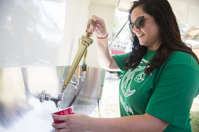 Brie Petrilli pours a beer during the Kirkwood Spring Fling. Photo: Jonathan Phillips