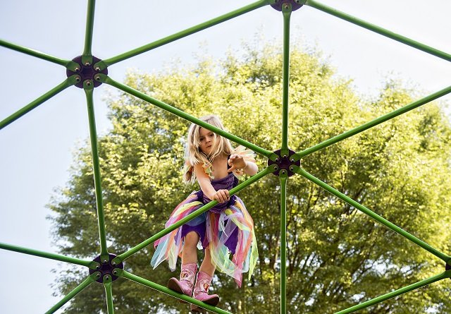 Gabby Didas plays on the monkey bars at Bessie Branham Park during the Kirkwood Spring Fling. Photo: Jonathan Phillips