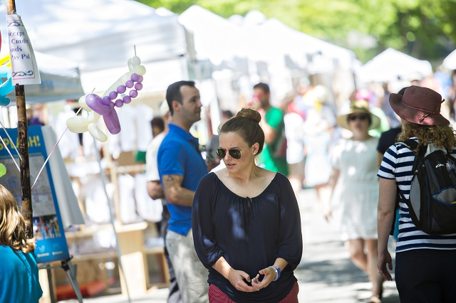 Glennleigh Boyd (center) walks past artist booths during the Kirkwood Spring Fling. Photo: Jonathan Phillips