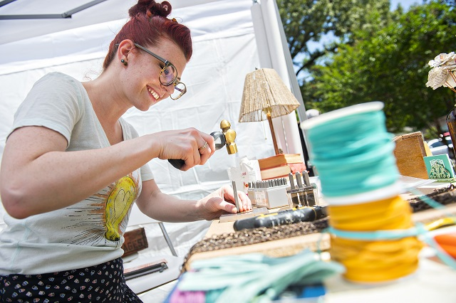 Rachel Felker hand stamps a copper necklace during the Kirkwood Spring Fling.  Photo: Jonathan Phillips
